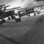 6 agosto 1941. Protezione dei C.R. 42 del 160° Gruppo nell'hangar Nervi Foto: Ass. 4° Stormo Gorizia